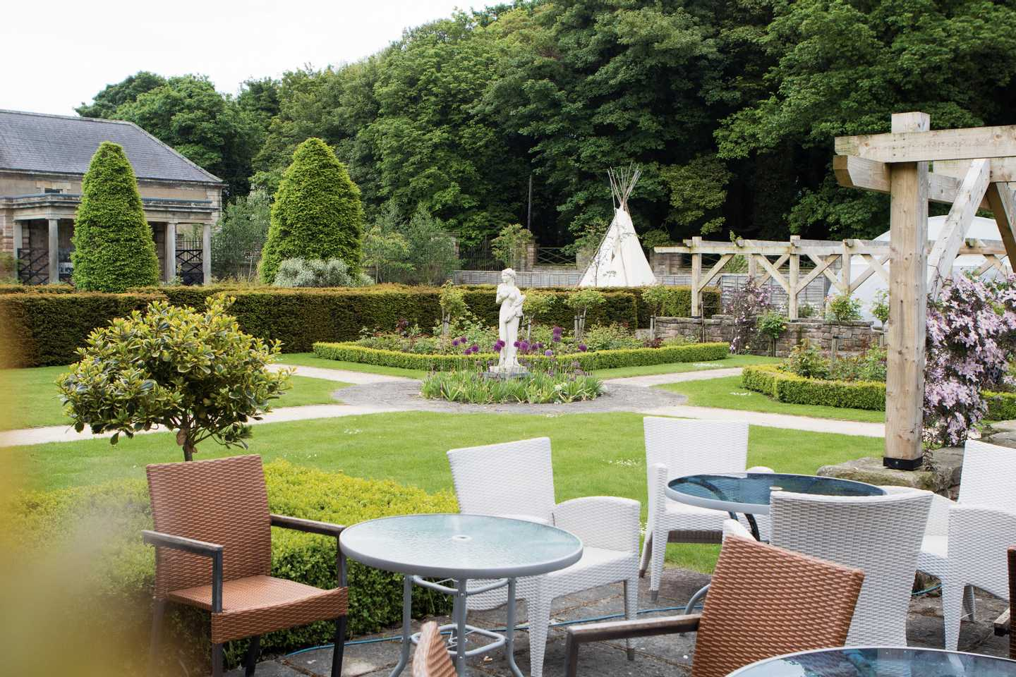 A scenic view from a patio area of our Italian gardens