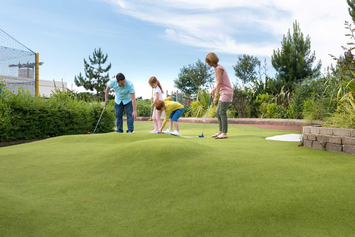 Family playing on the adventure golf course