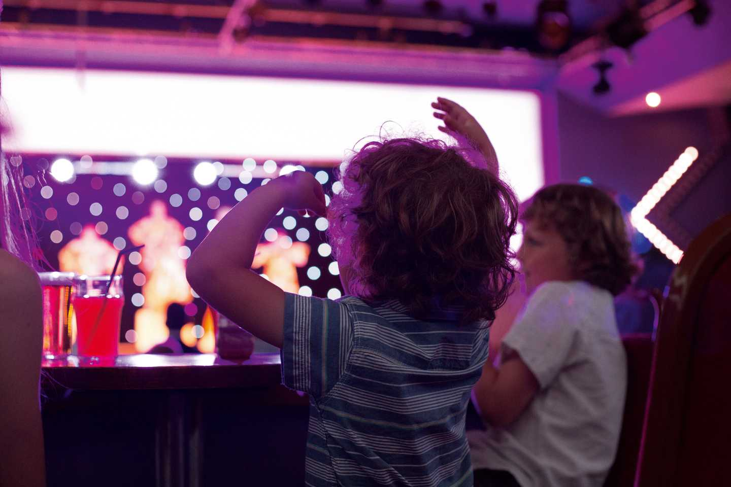 A pair of children enjoying the show in the Live Lounge