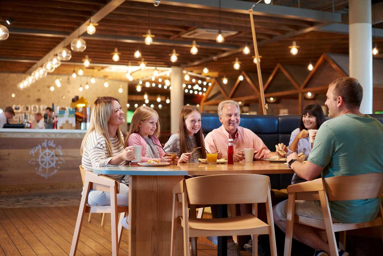 Family enjoying food at our Quayside Café Bar