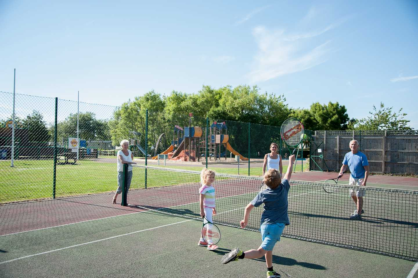 A family playing tennis