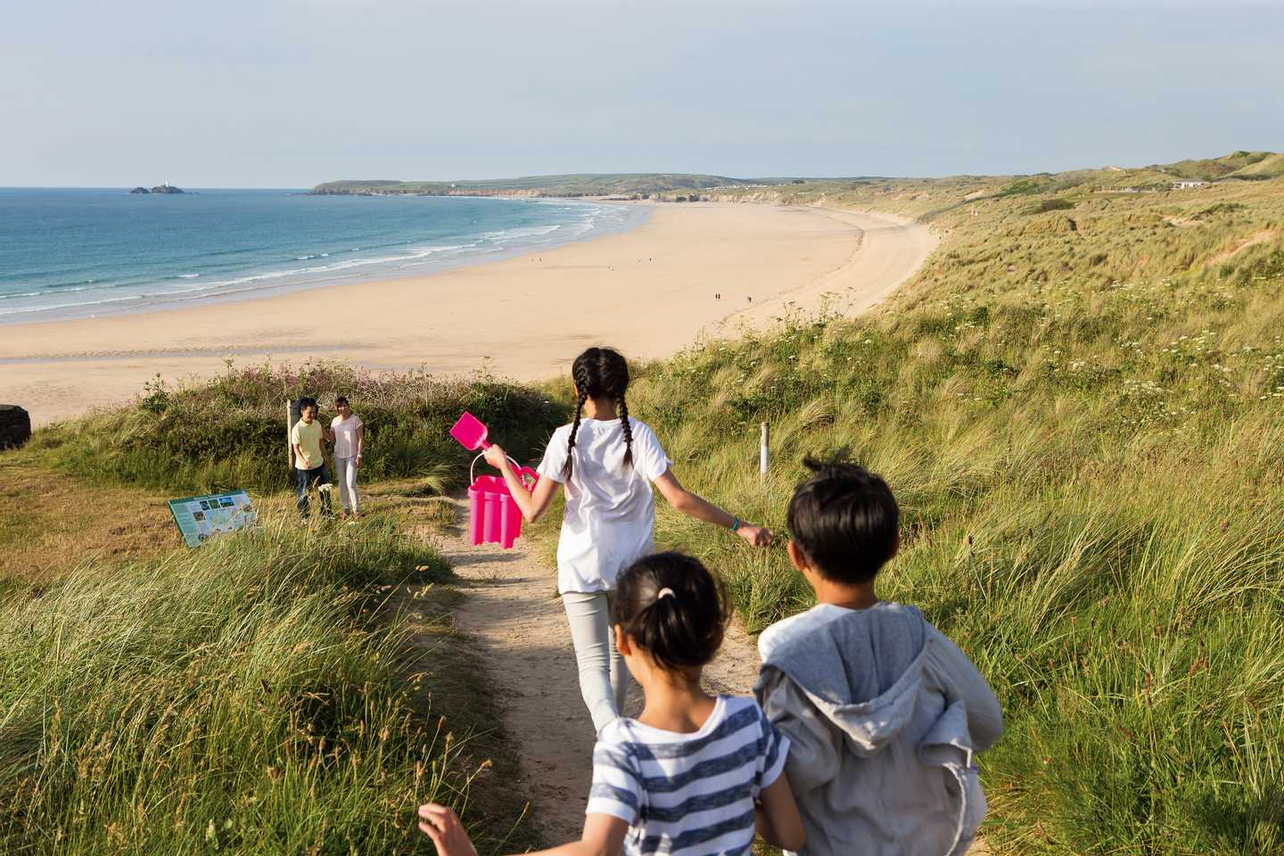 Children walking down to the beach at Riviere Sands