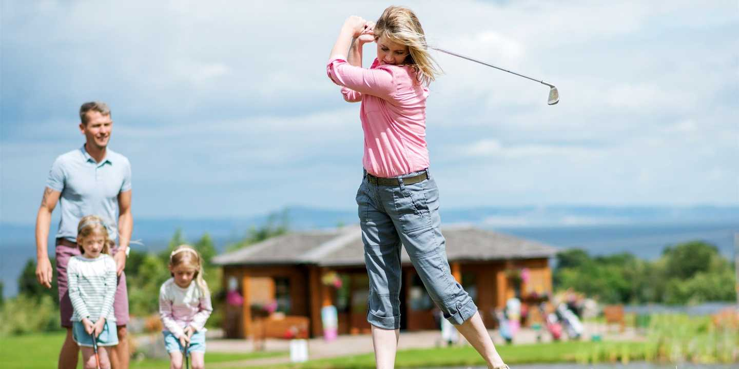 Lady playing golf at 9-hole golf course