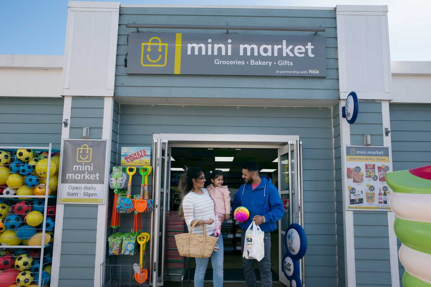 Guests exiting the Mini Market convenience store on park