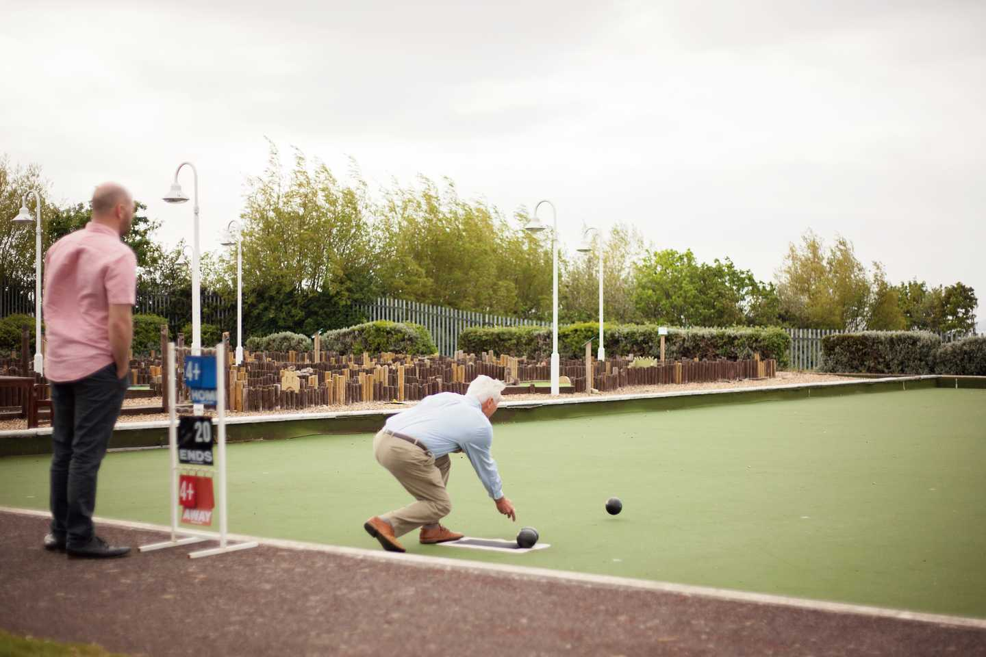 A guest bowling on the bowling green