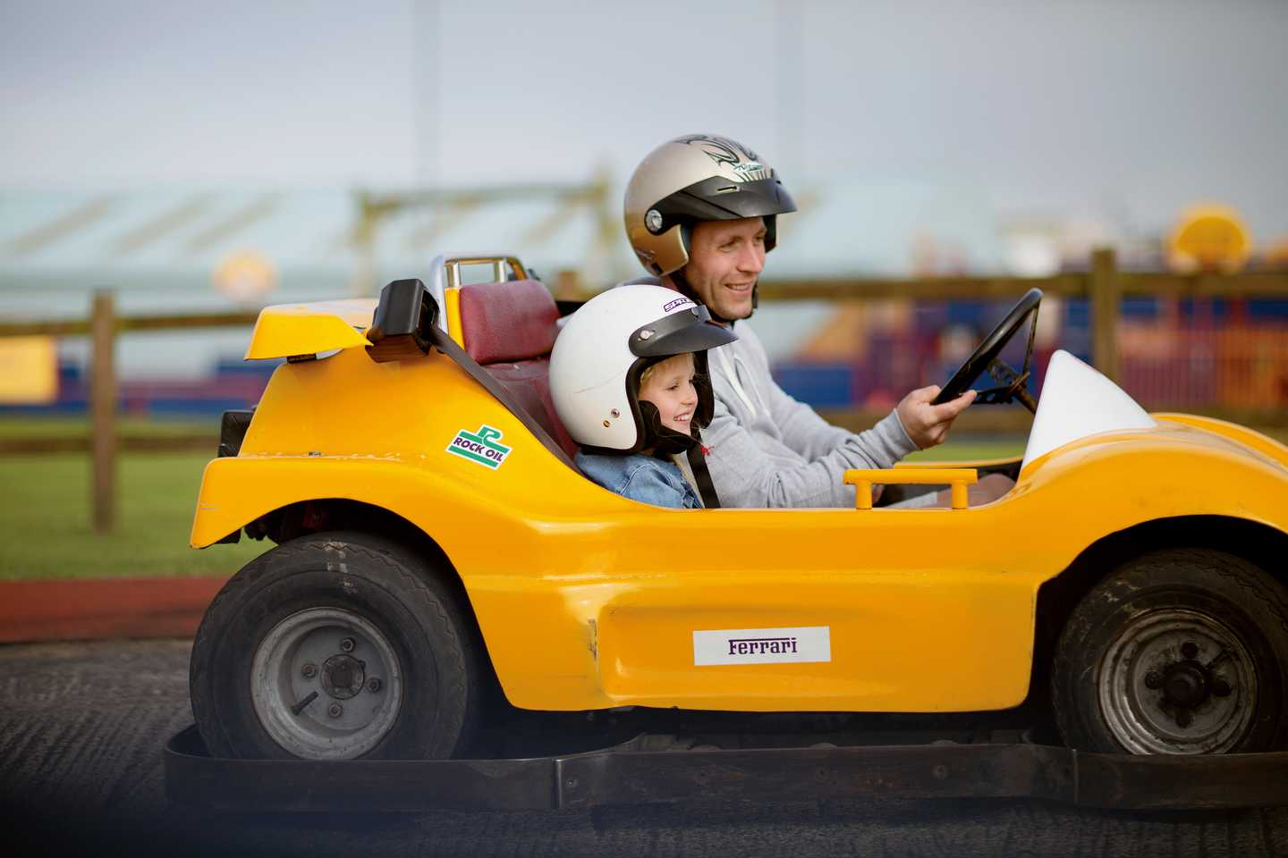 Family racing round the go-kart track