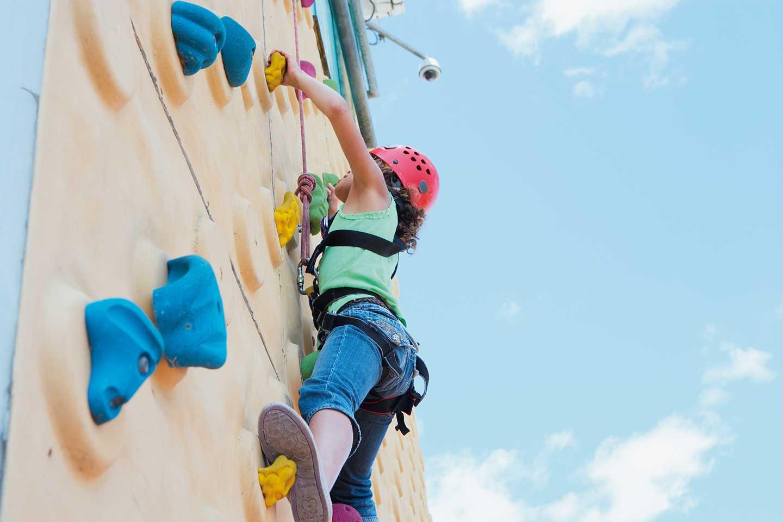 A guest climbing a climbing wall