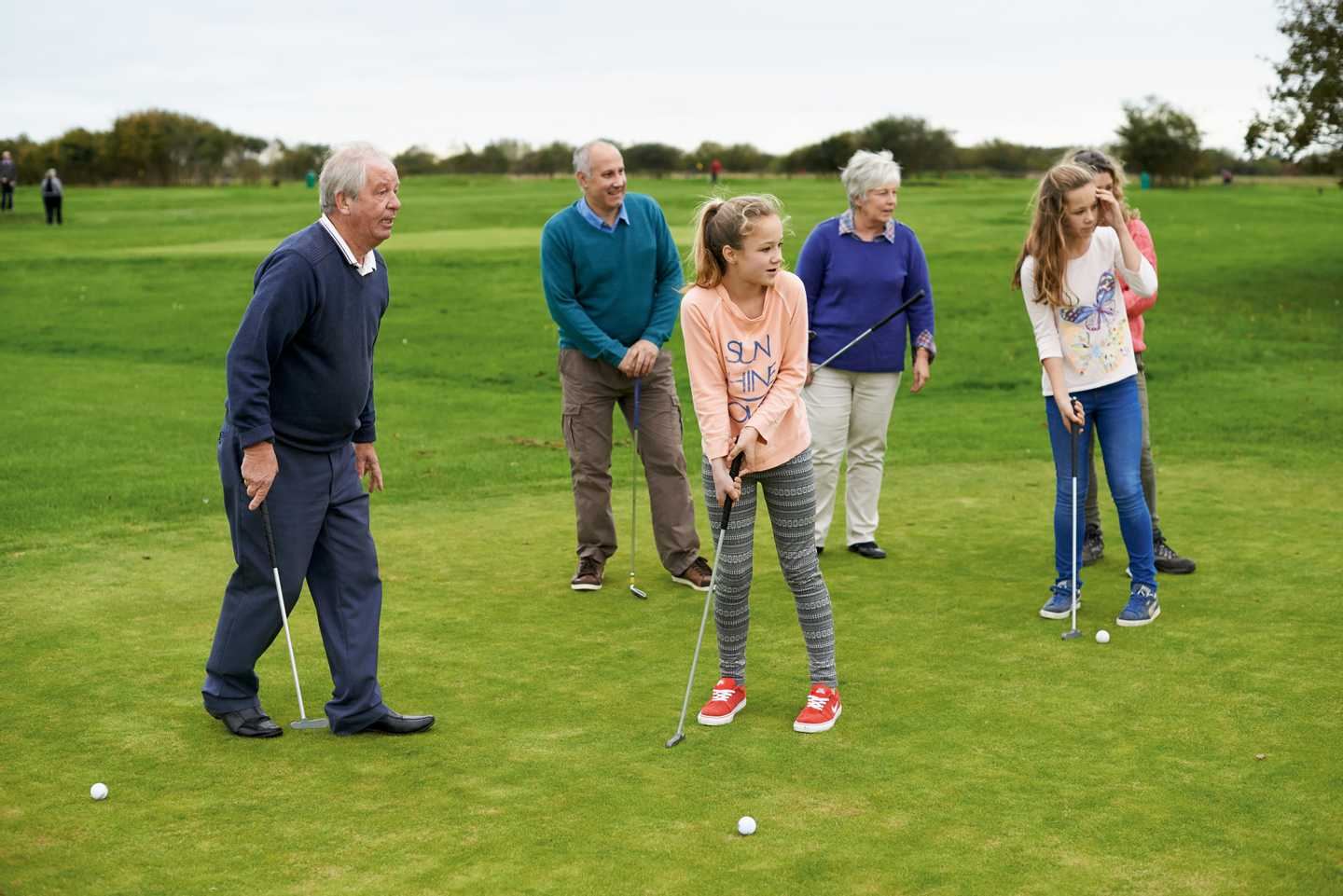 Family enjoying a game of golf at Church Farm