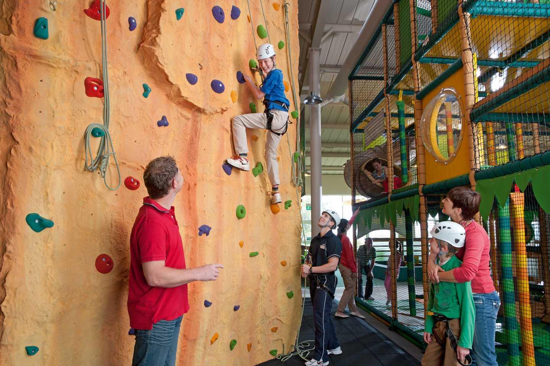 Child climbing climbing wall