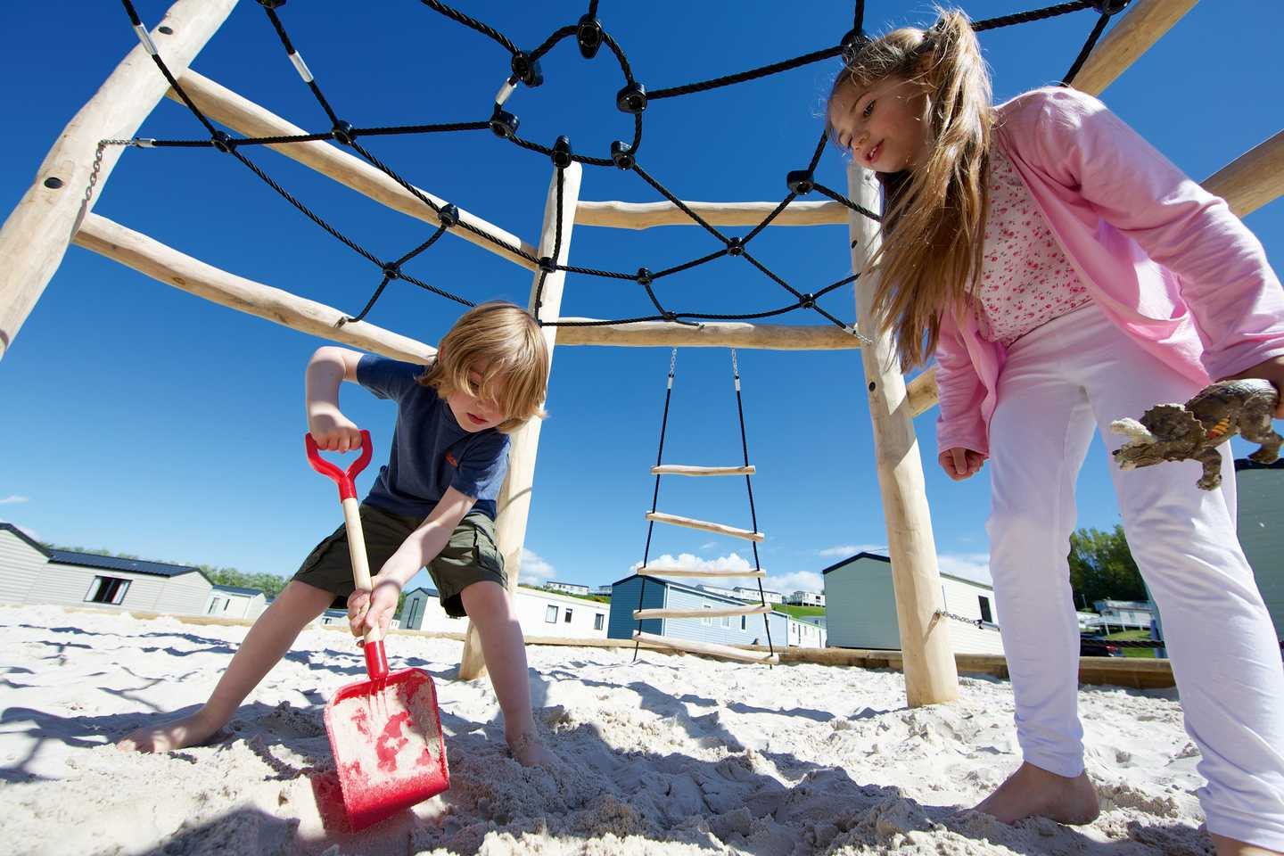 Children playing with sand in the outdoor play area