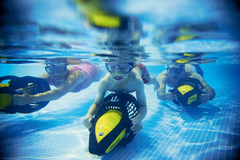 Family enjoying AquaJets in pool
