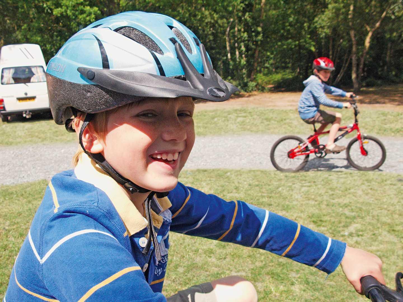 Smiling boy on bike