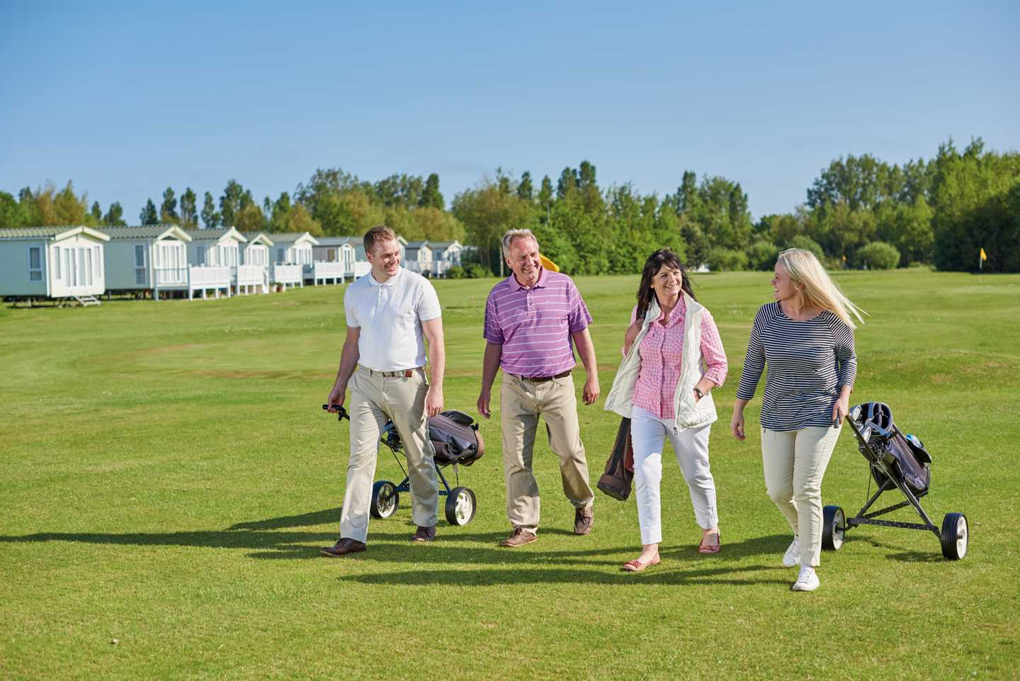 Adults walking along the 9-hole golf course
