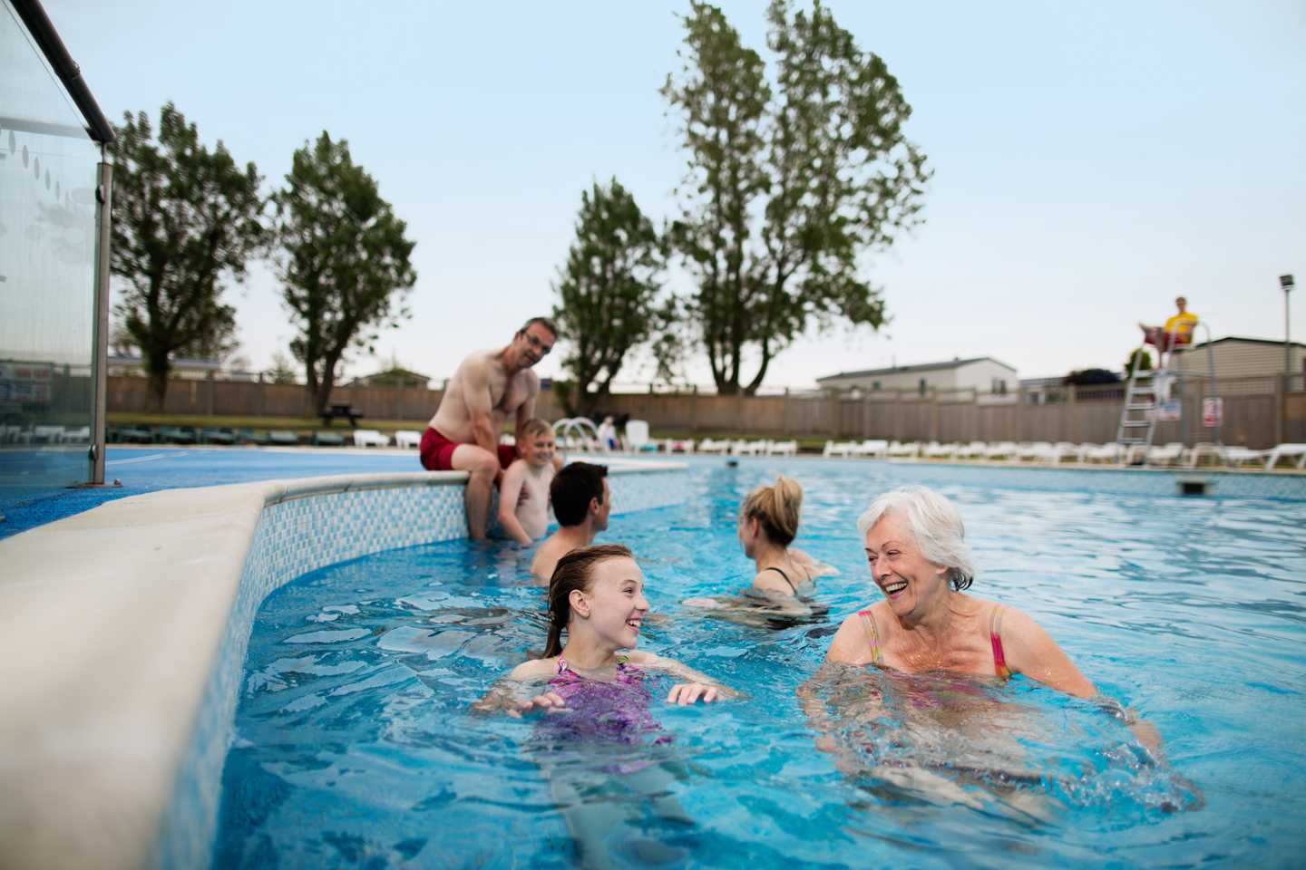 A family swimming around our large heated outdoor pool
