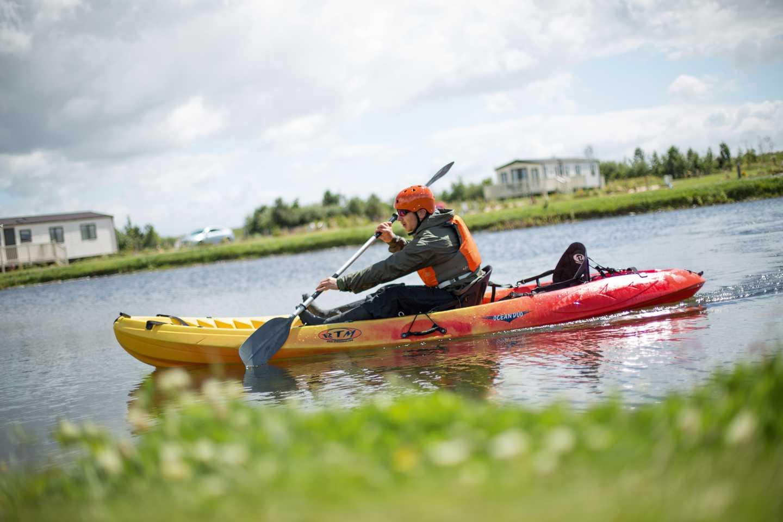 Man on lake in kayak