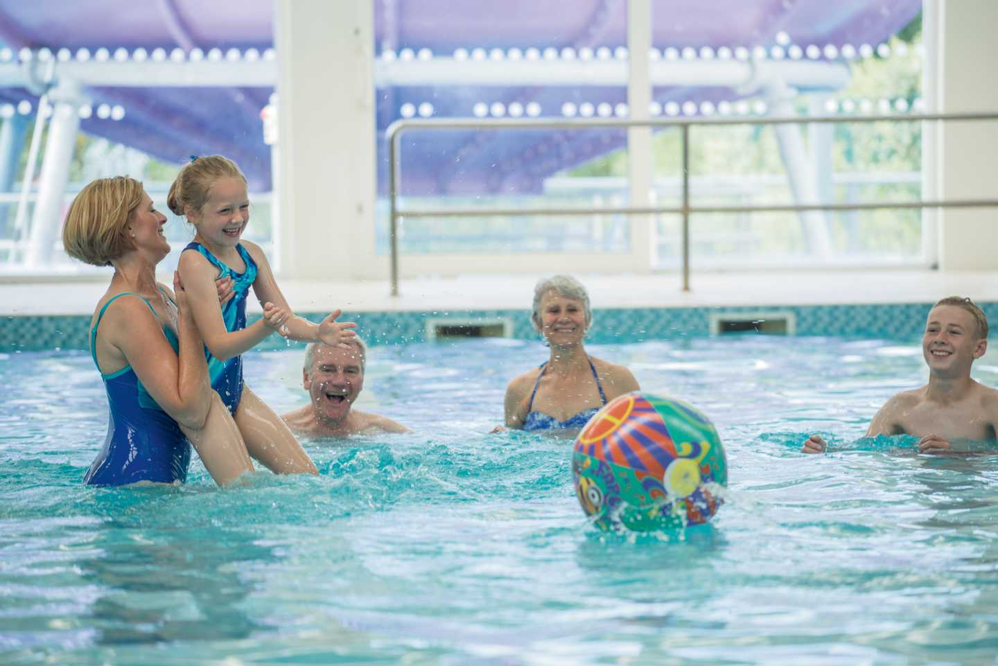 Family splashing about in the heated indoor pool