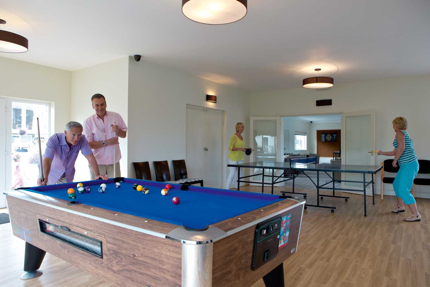 Guests playing snooker in the Owners' Lounge