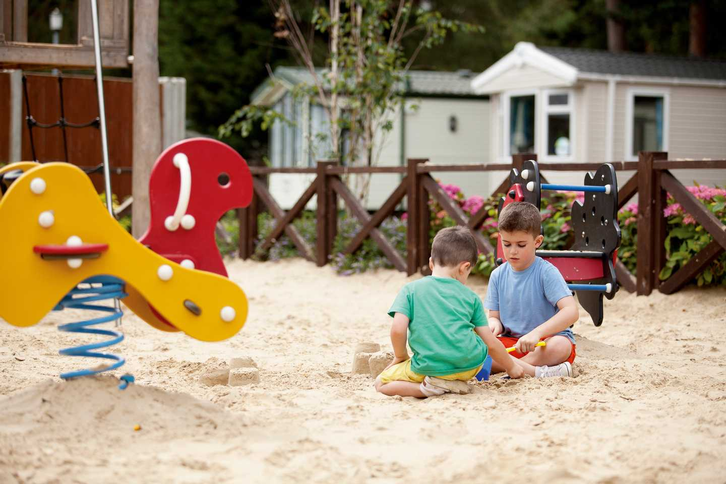 Two children playing in the outdoor play area