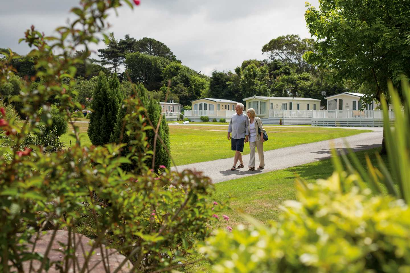 Owners walking through Garreg Wen Caravan Park in North Wales