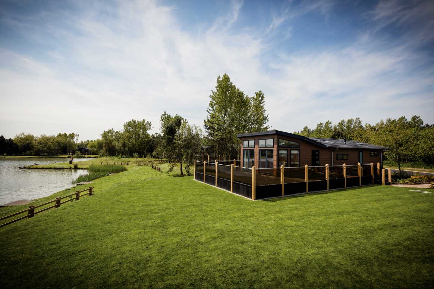 The green, open space by our lodges at The Lakes development in Far Grange