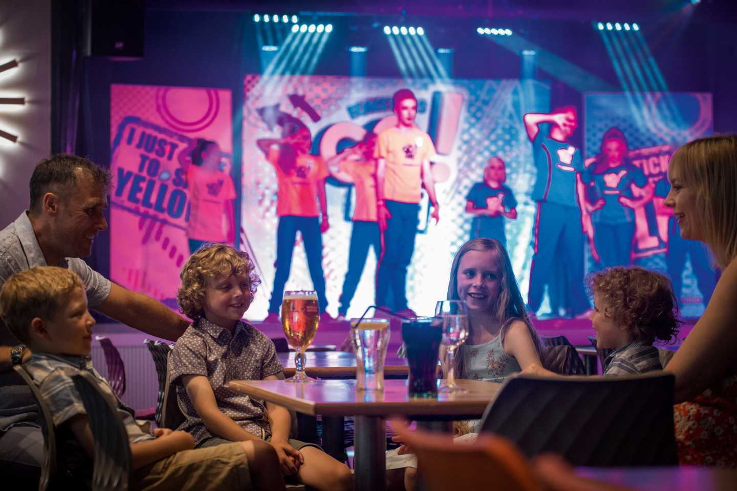 A family enjoying the entertainment in the ShowBar