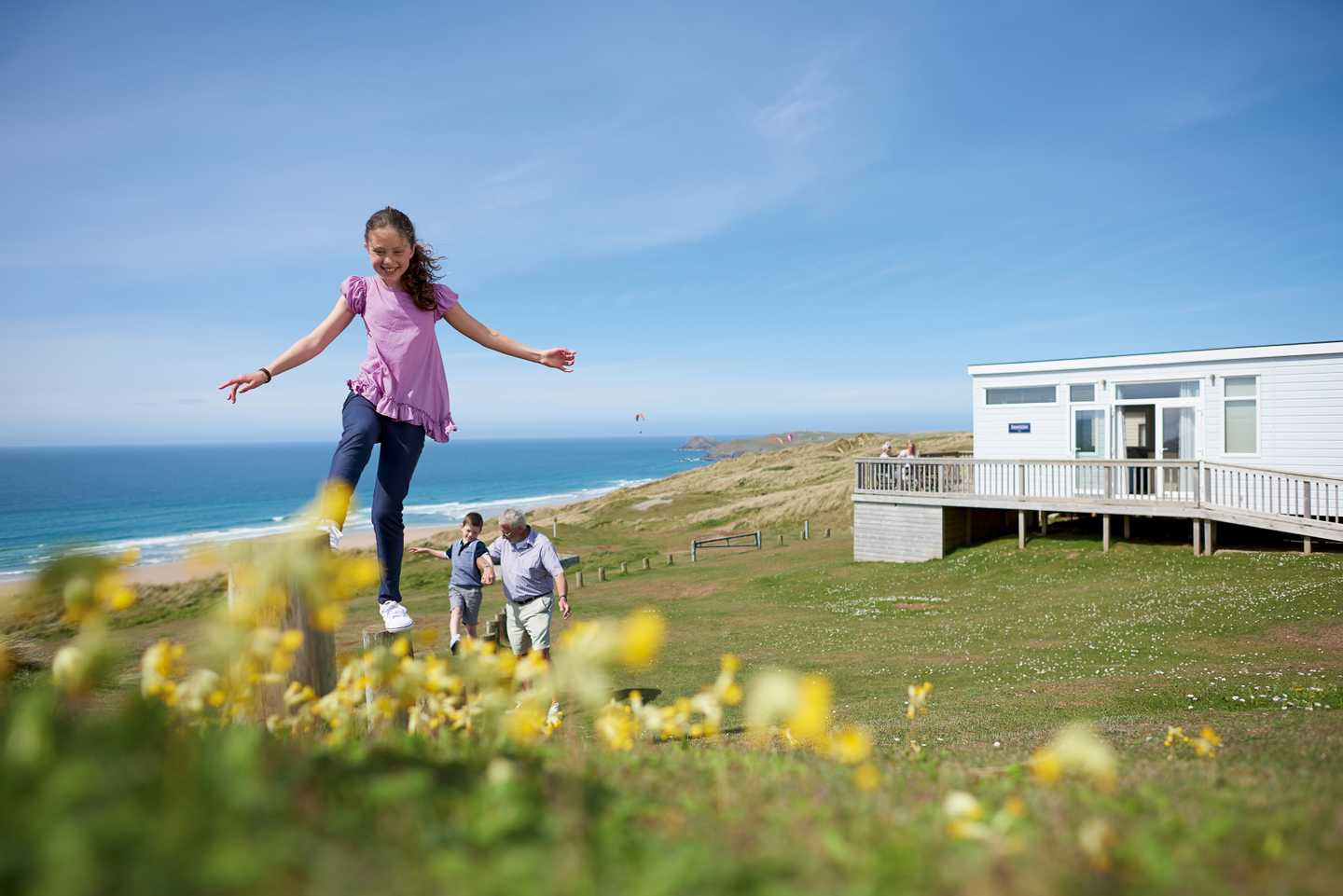 A girl playing nearby her caravan accommodation at Perran Sands