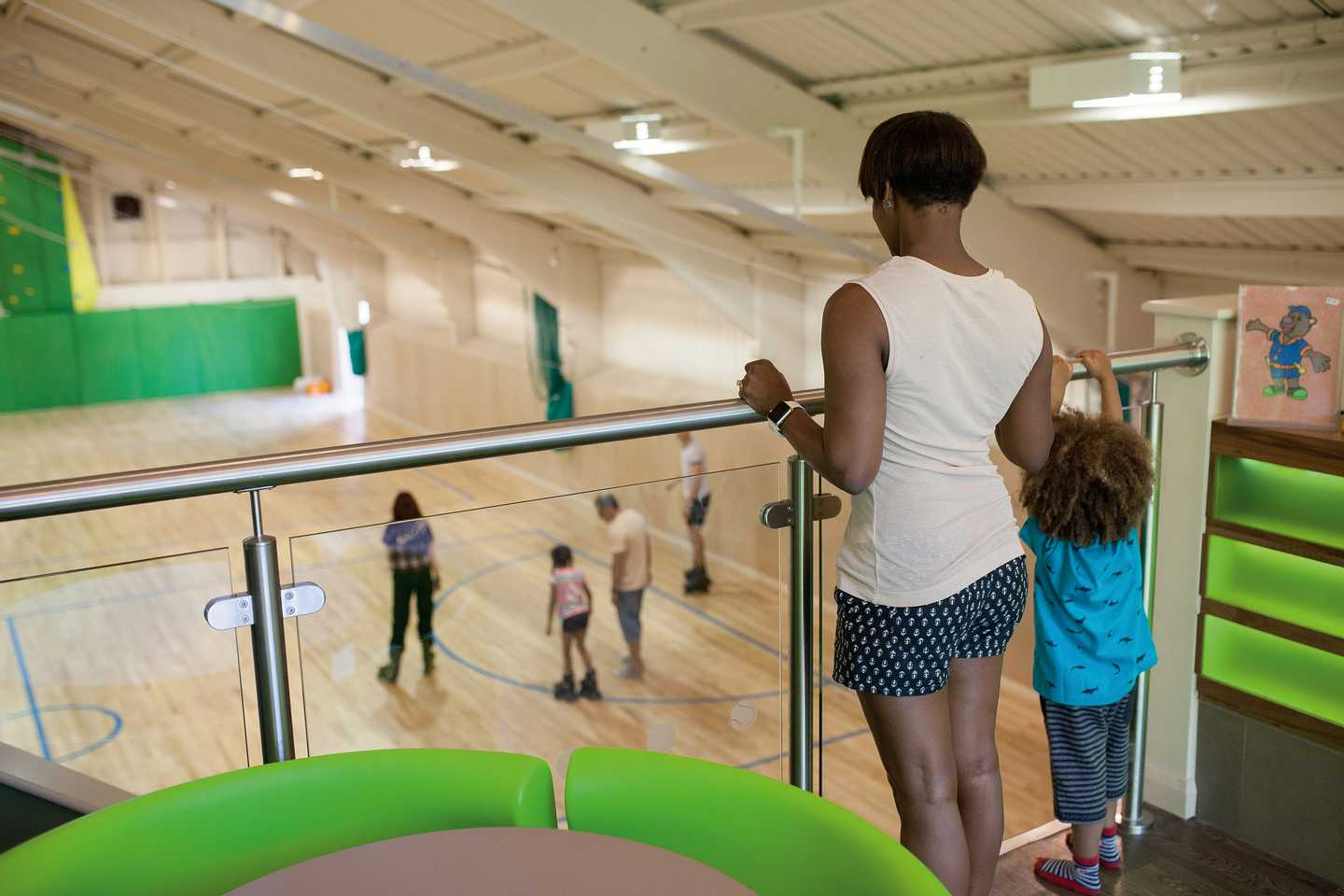 A family watching the roller skating from the balcony in our Airspace SportsDrome