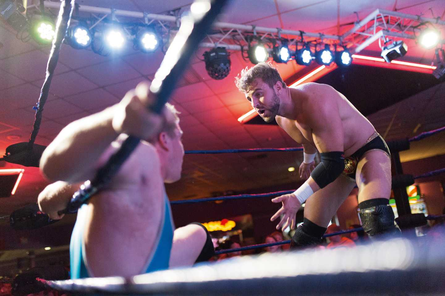 Wrestling stars battling it out in the ring