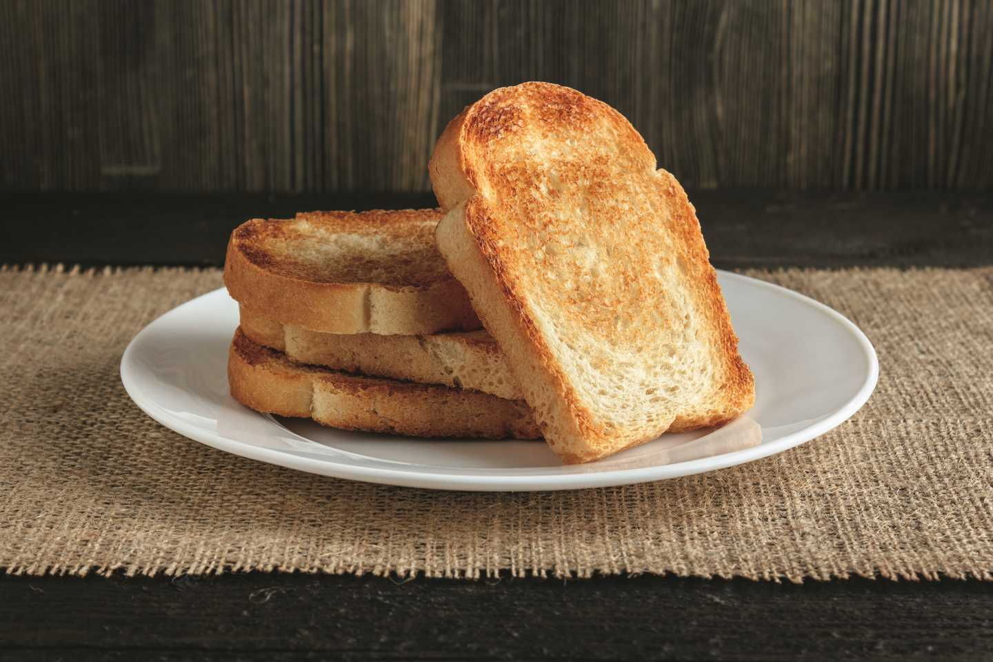 Four slices of golden toast on a plate