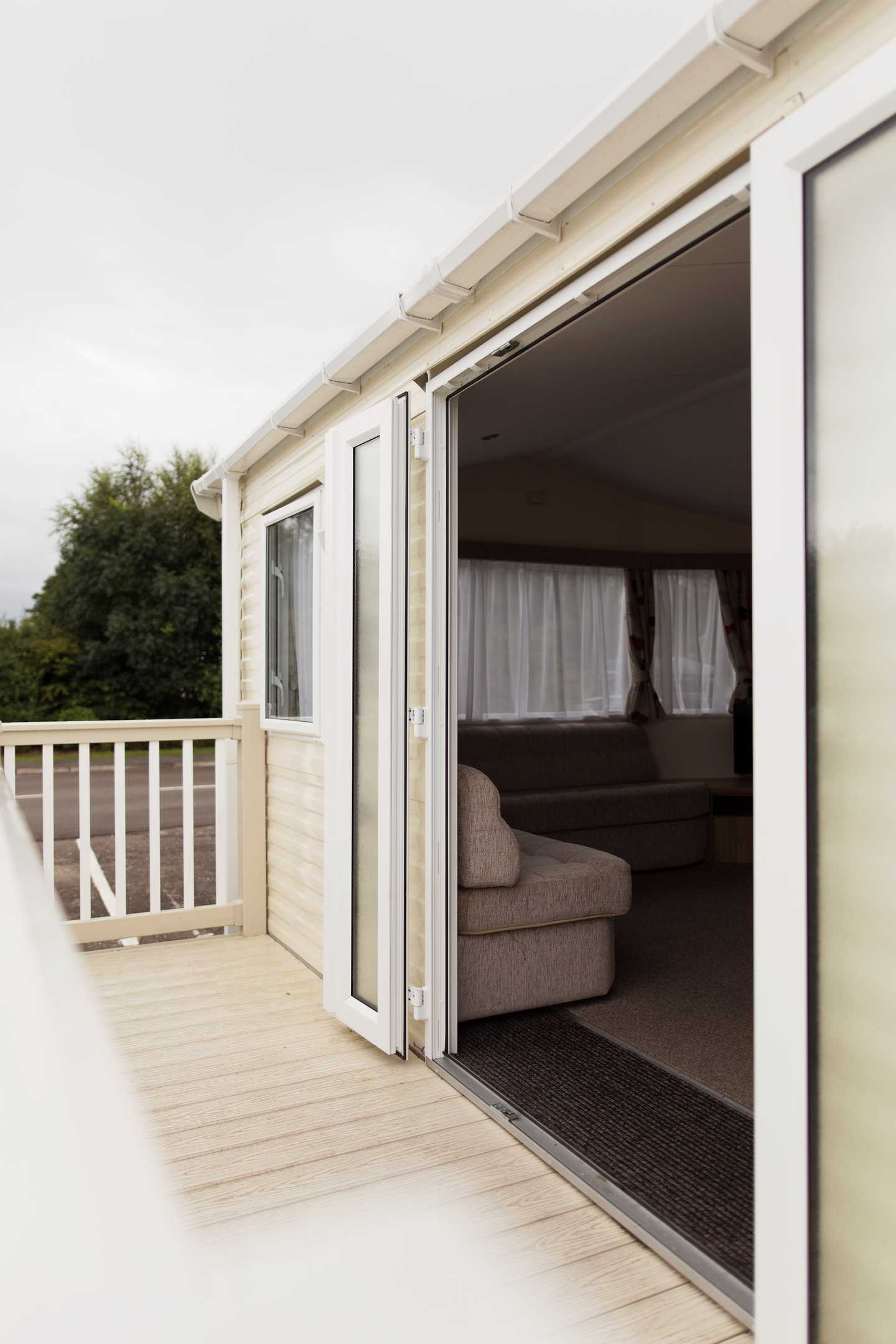 An Adapted caravan doorway to the wheelchair access ramp