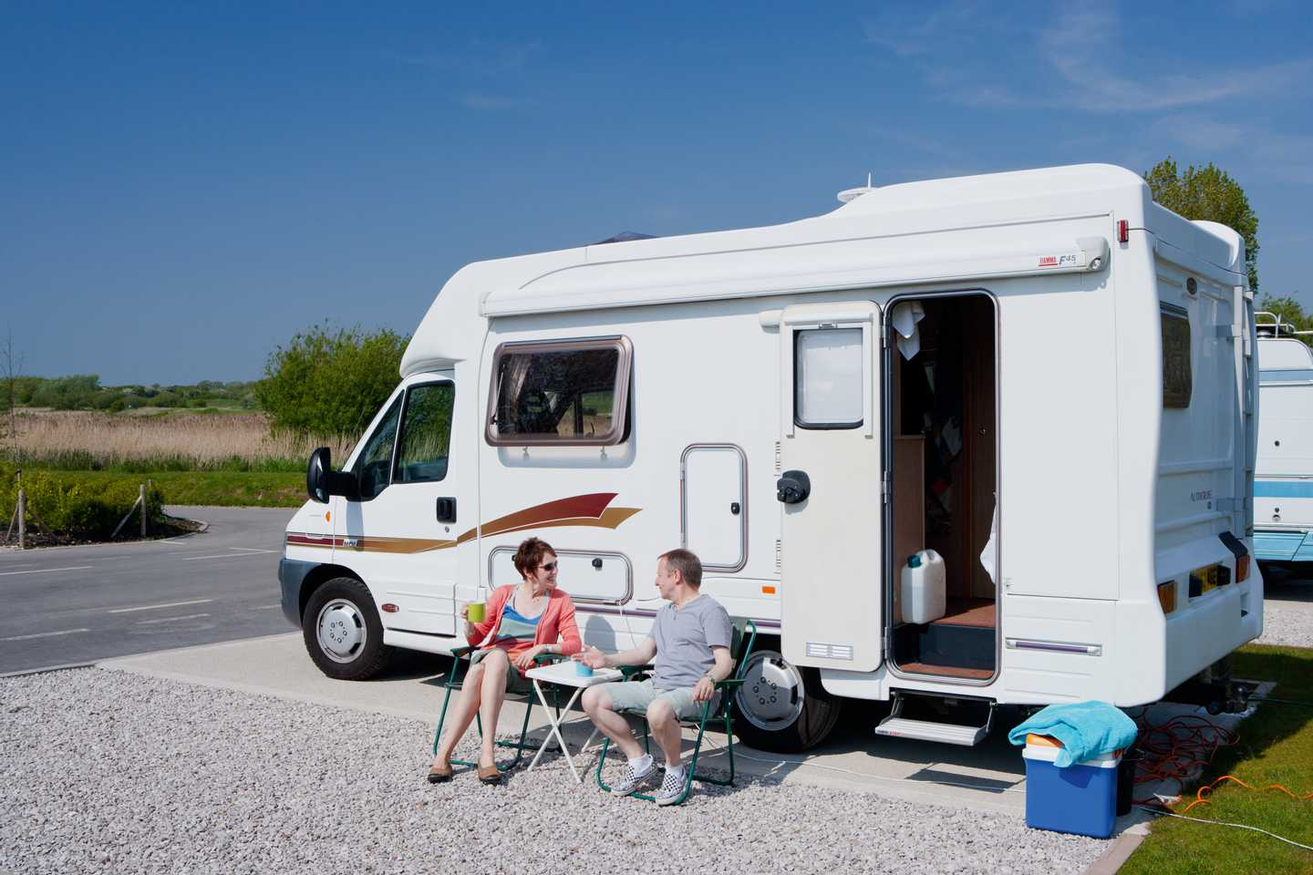 A pair of guests outside their motorhome