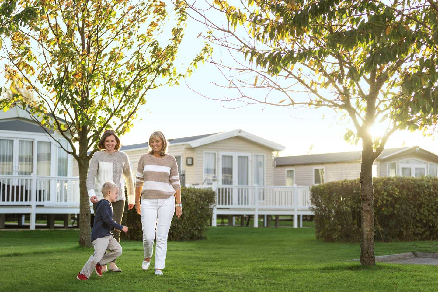 A family walking through Hopton Holiday Village