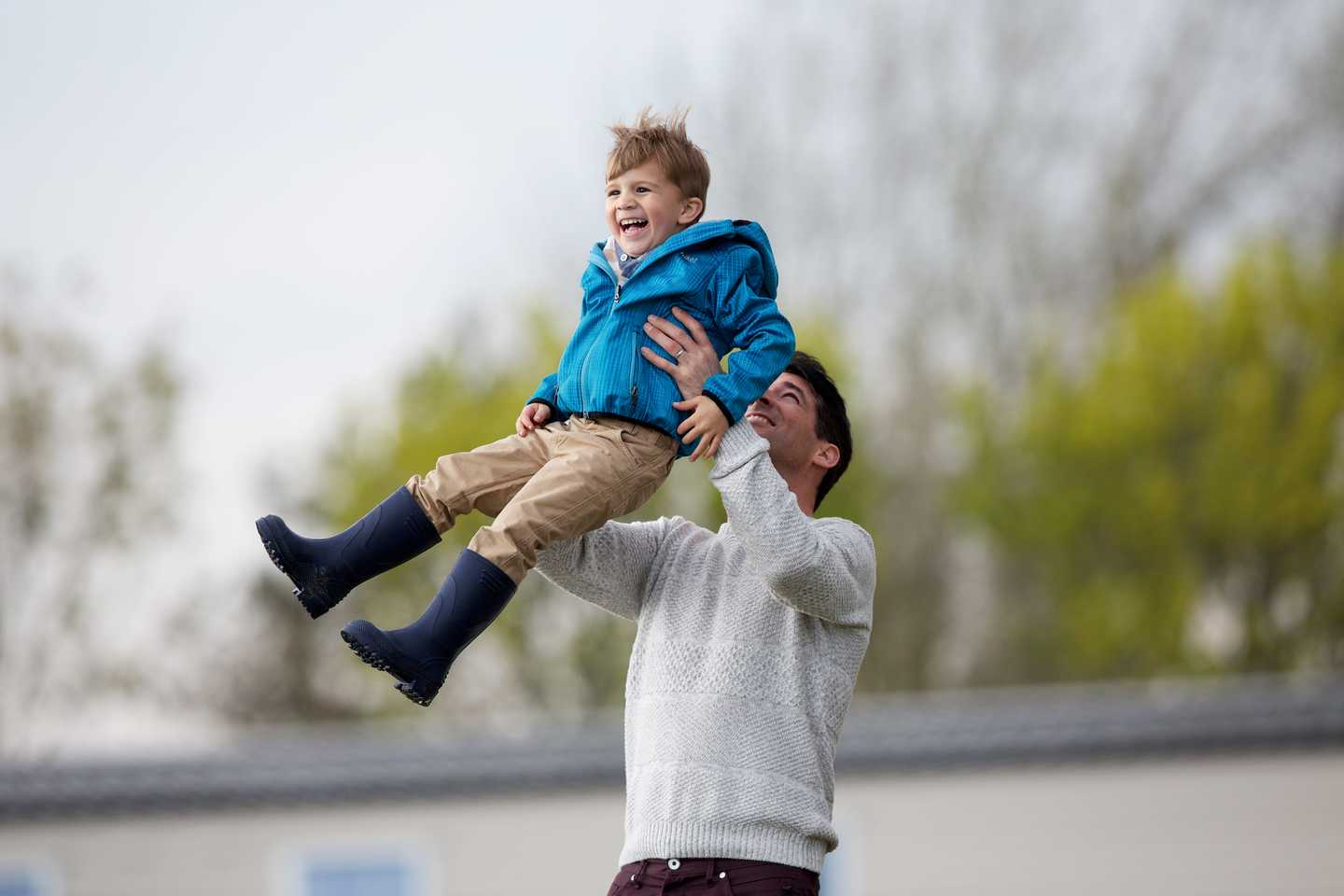 A father and son playing outside