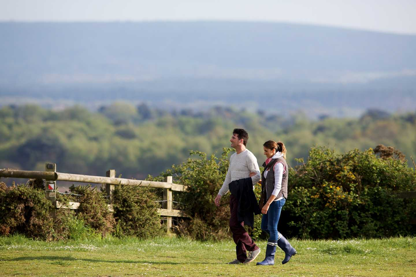 Couple walking together in a field