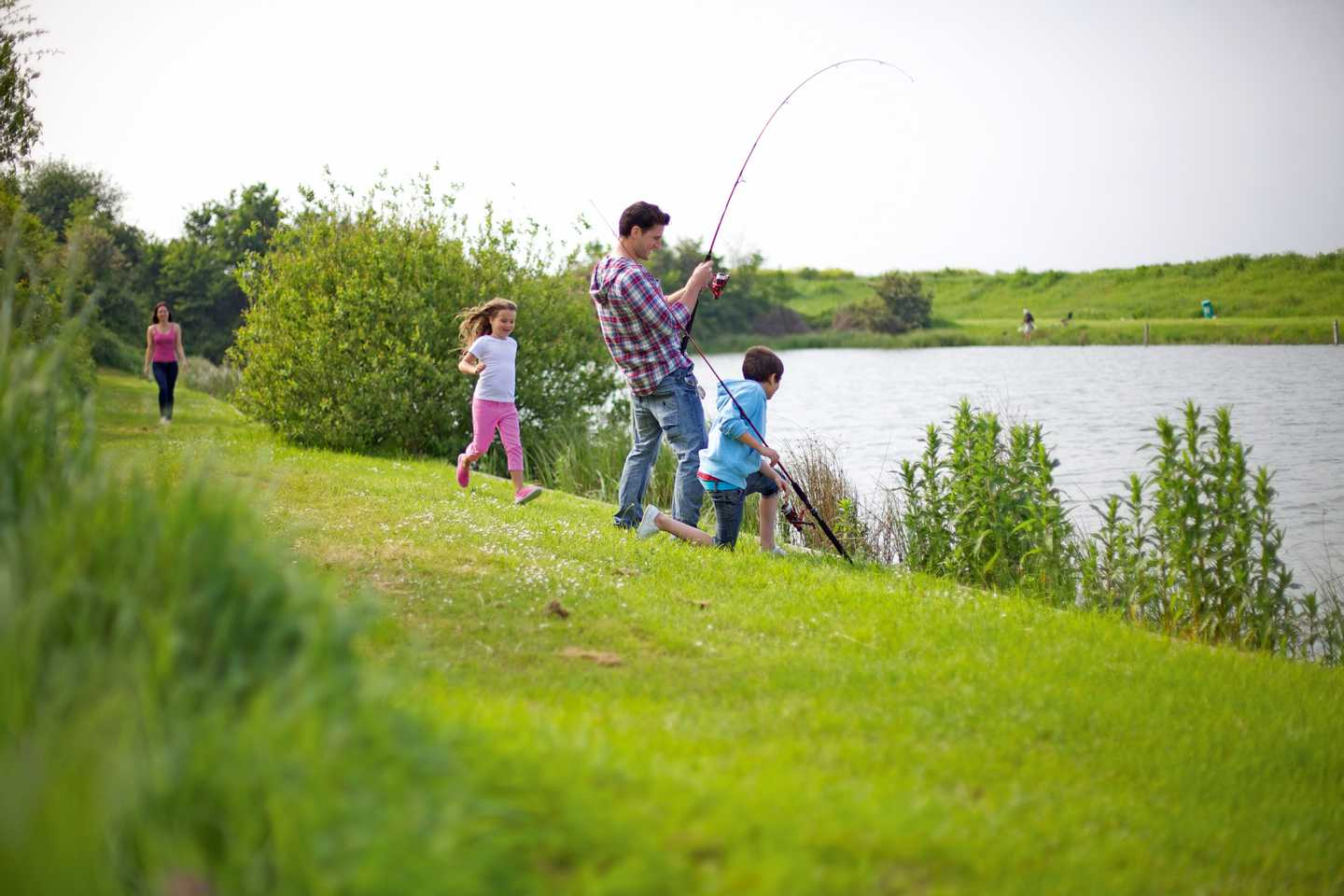 Family fishing at the fishing lake