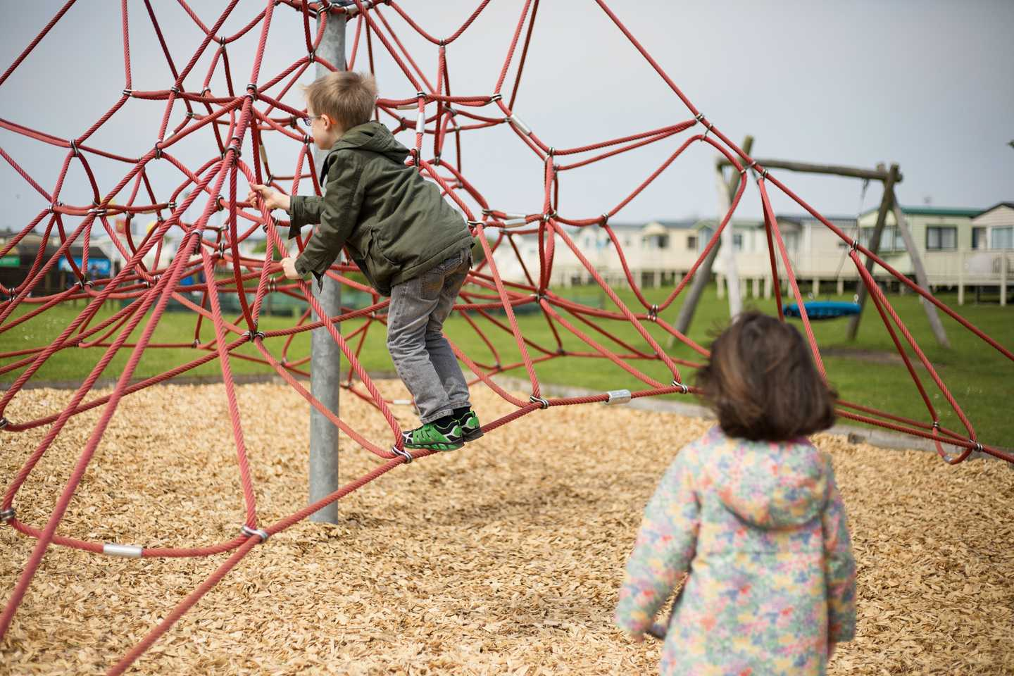 Children climbing ropes in the outdoor play area