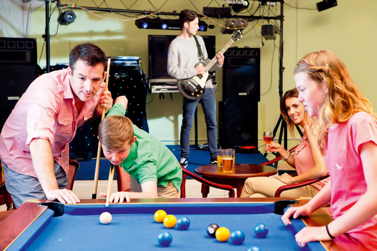 A family playing pool