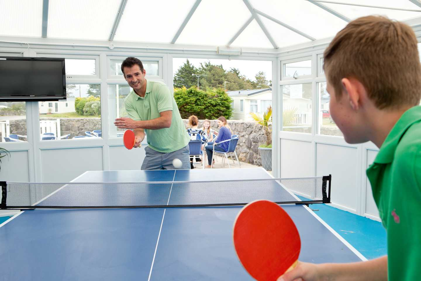 A father and son playing table tennis