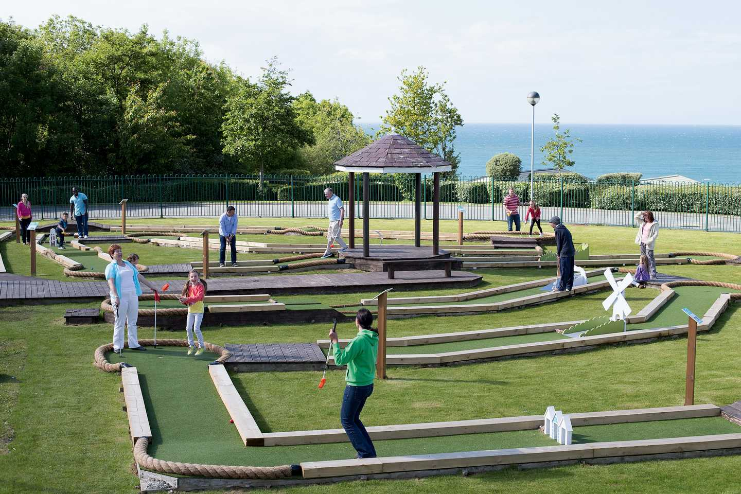 Family playing on the crazy golf course