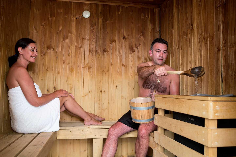 A couple enjoying the owners' sauna