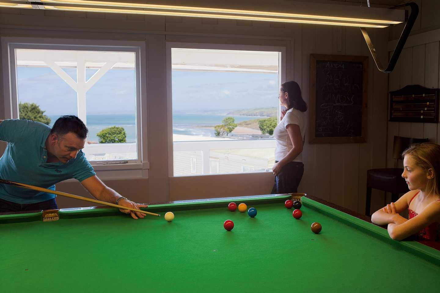 Guests playing snooker