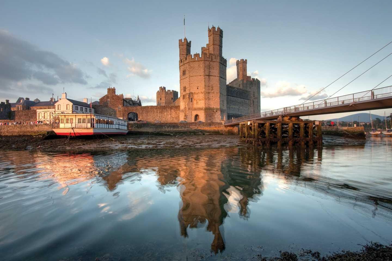 Caernarfon Castle reflecting into the River Seiont